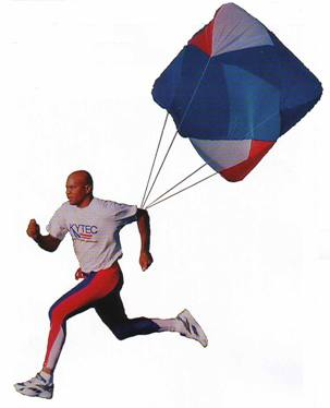Blue, red and white parachute attached to a runners back.  Used for resistance training for athletes