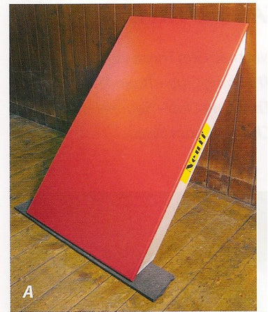 Solid board leant up against a wall at an angle.  Used to help quick turning against the wall when running indoors.