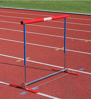 Polanik hurdle with a red cross bar and base, and blue legs.  Base is sprung to come back upright if knocked over
