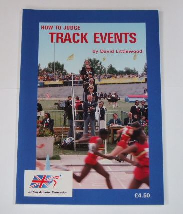 Book featuring a photo of track officials judging the end of a sprint race, with a blue border.  How to judge track events, by David Littlewood.  Endorsed by British Athletics Federation (now UKA)
