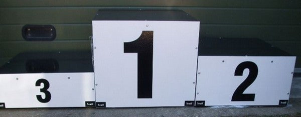 Set of three numbered boxes of different heights for winners to stand on to collect medals