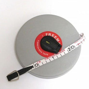 Cased tape measure in a silver case with white tape and red and black winding handle