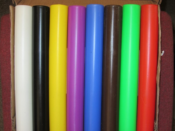 Set of 8 coloured plastic relay batons