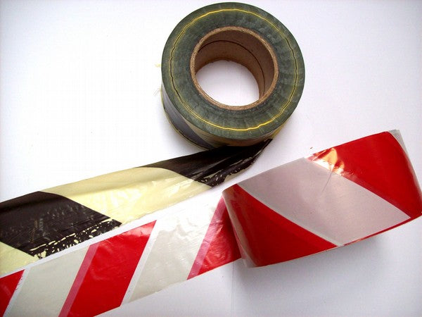 500m roll of polythene safety tape, with either black/yellow or white/red diagonal stripes