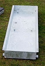 Steel trough to be inserted into the ground as a foundation for take-off board