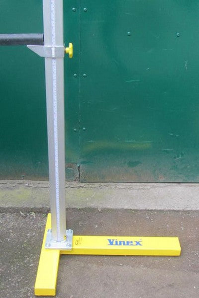 High jump upright for holding cross bar.  Aluminium with a yellow steel base