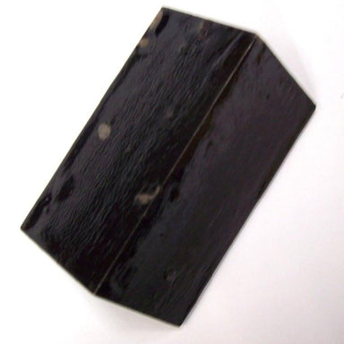 Rectangular black block with a knife edge used to balance javelins to find their centre of gravity