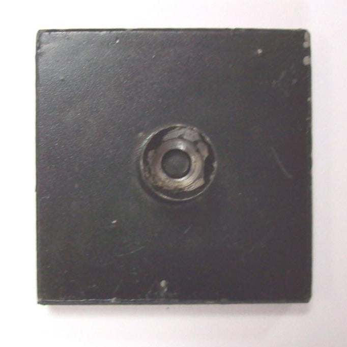Square black block with a circular knife edge used to balance shot and hammers to find their centre of gravity