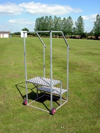 Steel stand with 2 steps and a handrail for starter to stand on.  Wheels at the back.