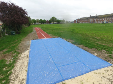 Blue PVC mesh cover with heavy seams to cover a sand pit for long jump and triple jump