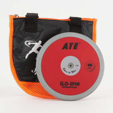 ATE Slo-Spin discus.  Red discus with dark steel rim. With orange and black carry bag