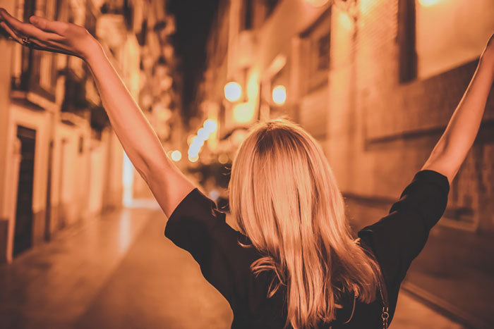 Woman celebrating in the street