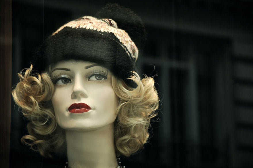 Mannequin wearing a wig and hat