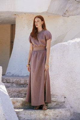 Organic, airy linen and cotton-blend maxi skirt with light gathers. Decorated with Signature Sense Swim ® golden pendant. Featuring an elasticated waistband at the back. The wide hem moves prettily with every step.