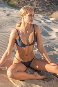 Embody the essence of your divine generative power with NOUSA skinny bikini bottom. Accented by our heat resistant and waterproof Sense Swim ® pendant at the hip, this fully lined style is a statement that accentuates your natural beauty.