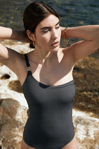 Awaken your senses in our most loved maillot. The PUJA one-piece swimsuit breezes across the body in an asymmetrical cut accented by the signature Sense Swim ® golden hardware in the front. While our unique concealed silicone elastic firmly caresses the figure and décolletage along with an adjustable strap.