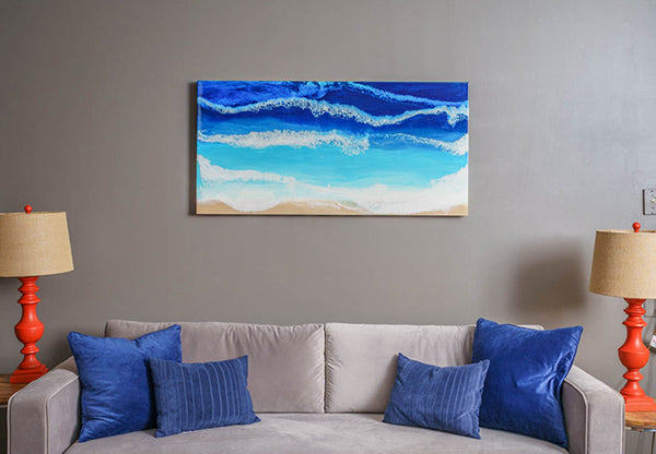 The Pacific original acrylic and resin ocean painting by Siroh & Ivy with deep and rich blues on grey living room wall
