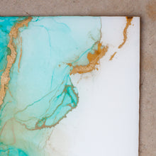 Load image into Gallery viewer, Serenity is an original piece of fine art from Siroh & Ivy that features resin mixed with hues of aqua blue alcohol inks and touches of gold leaf
