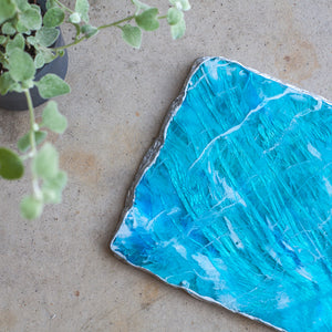 Agate inspired cheese board made of black cement, high-gloss resin, and silver from Siroh & Ivy