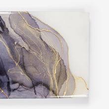 Load image into Gallery viewer, Ink well is a rectangular fine art resin painting by Siroh & Ivy with overlapping layers of grey alcohol ink overlaid with gold leafing and shimmering glitter
