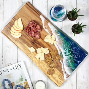 Solid maple serving board with ocean design painted on with food safe resin for great charcuterie