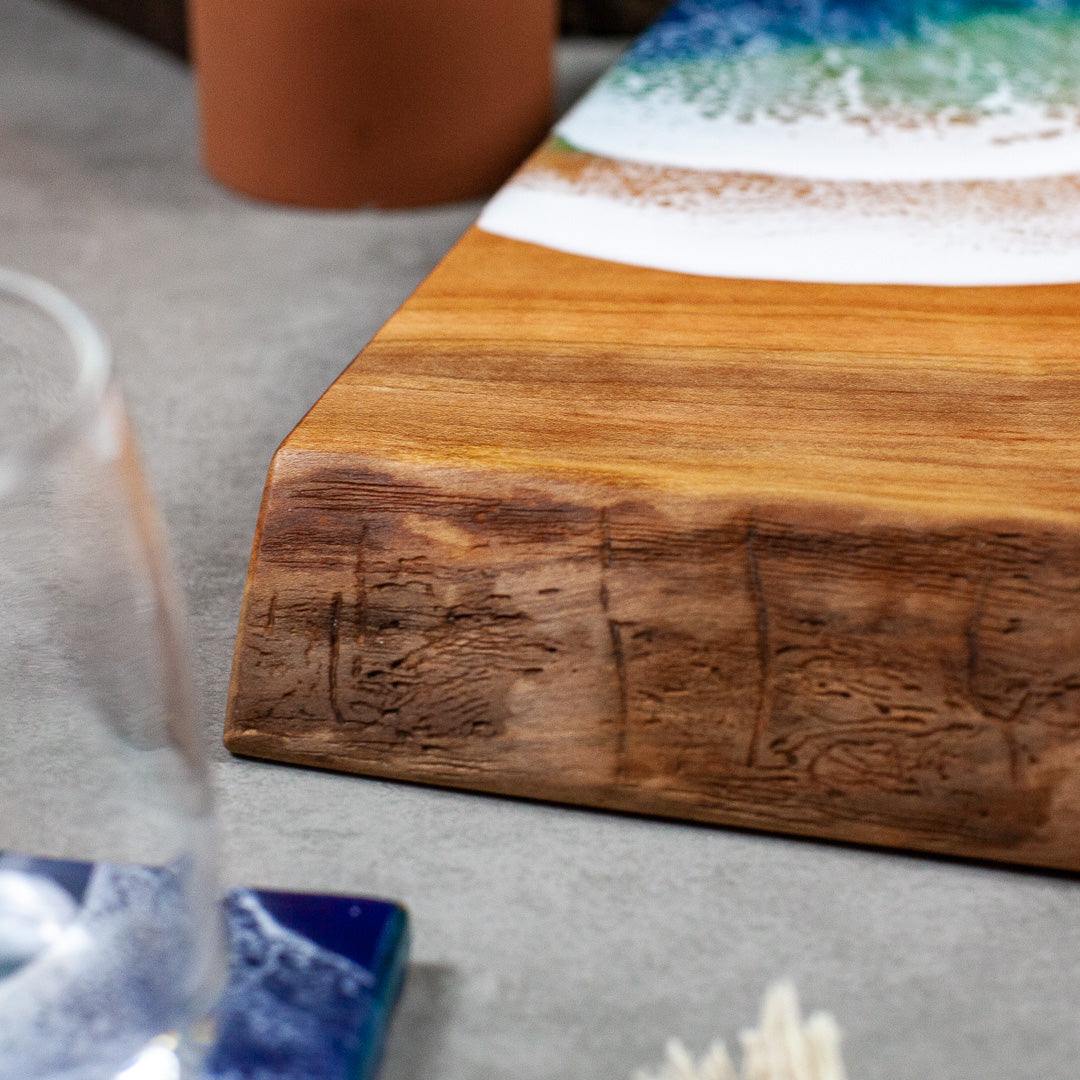 Solid cherry serving board with ocean design painted on with food safe resin for great charcuterie