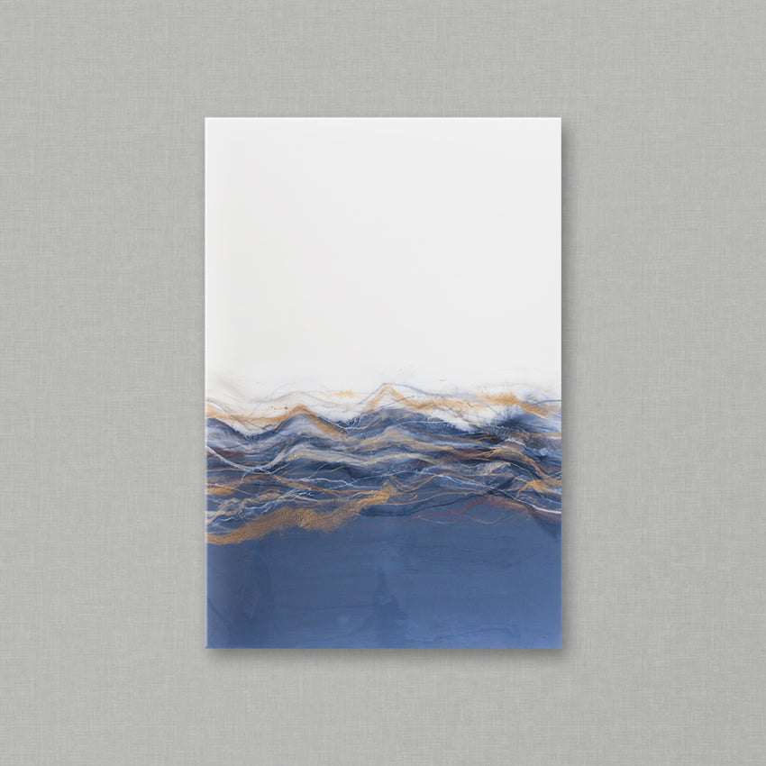 Sahara is an original piece of high-end resind art from Siroh & Ivy and features two juxtaposing sides of pure white and pale grey blue bisected by marbled lines of gold, champagne, grey, and dark blue