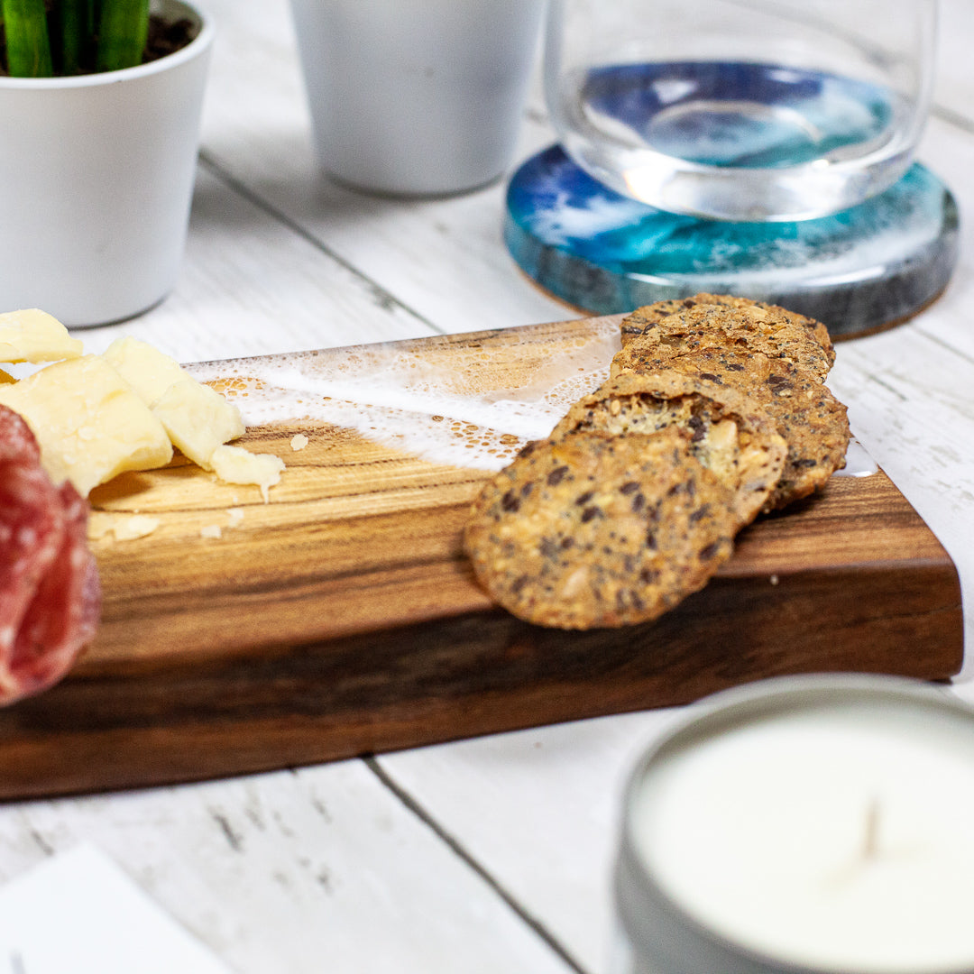 Solid maple serving board with sea foam design painted on with food safe resin for great charcuterie