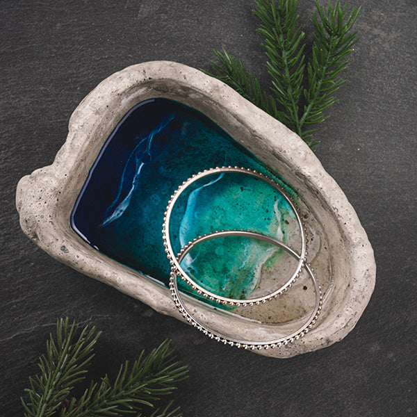 Ocean themed cement jewelry bowl with resin painted by Sarah Cunzolo of Siroh & Ivy with silver earrings