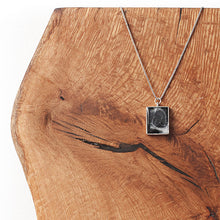 Load image into Gallery viewer, Hand-painted necklace from Siroh & Ivy featuring a rectangular pendant filled with black and white pigments and glitter that resembles a galaxy and a silver colored adjustable chain