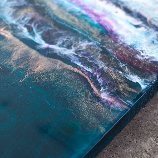 Sierra is a Siroh & Ivy original piece of acrylic and resin art on wood with a large section of pure white and dark green separated by pink, black, and gold ridges