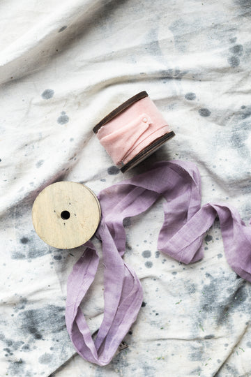 Ribbon spools on linen fabric