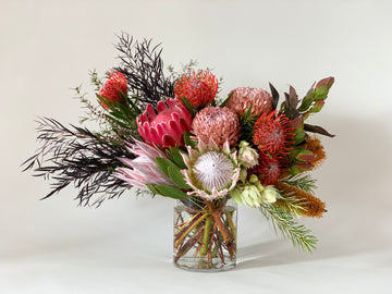 Native flower bouquet in vase