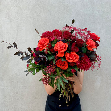 Bouquet of red roses and foliages.