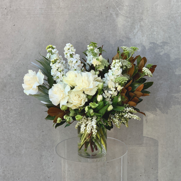 Vase arrangment of premium white and green flowers & foliages.