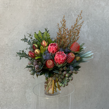 A vibrant arrangement of locally grown mixed native flowers & foliage