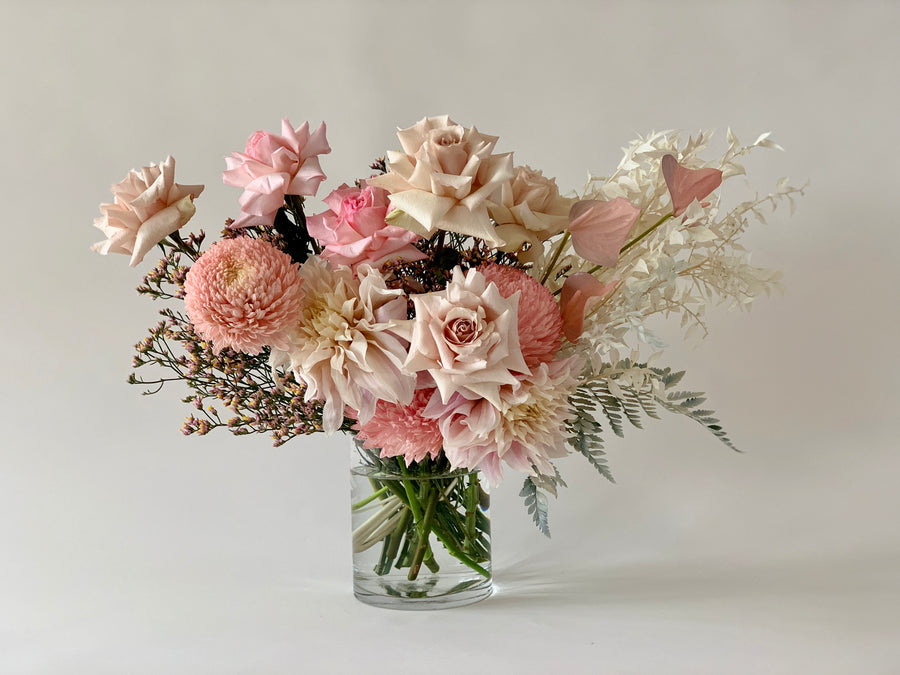 Blush toned flower bouquet in vase