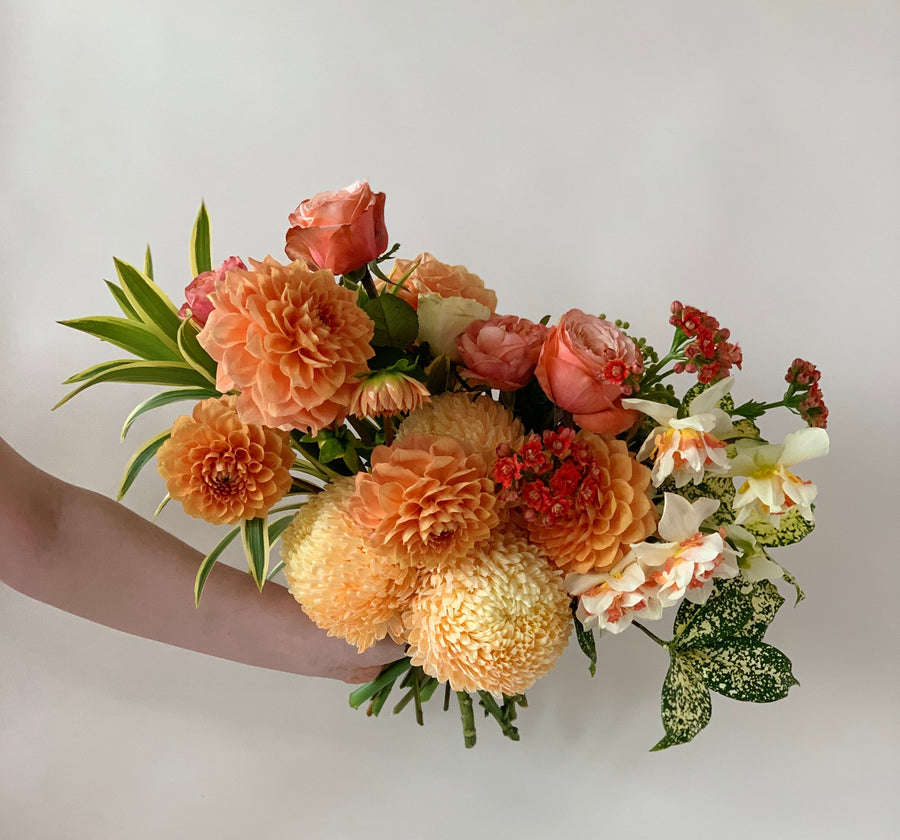 Bouquet of orange toned flowers