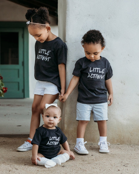 Apparel & Accessories > Clothing > Baby & Toddler Clothing > Baby & Toddler Tops - Little Activist ?id=18557286154394