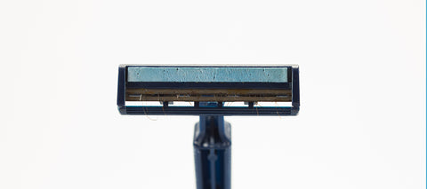 Black razor with blue color is prepared for the Boldnine's shaving cream