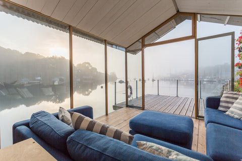 Morning view up the Penryn River in Cornwall, from Canopy & Stars' Barge Amelie
