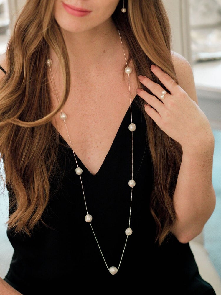Luxury jewelry. Baroque pearls. Long necklace.