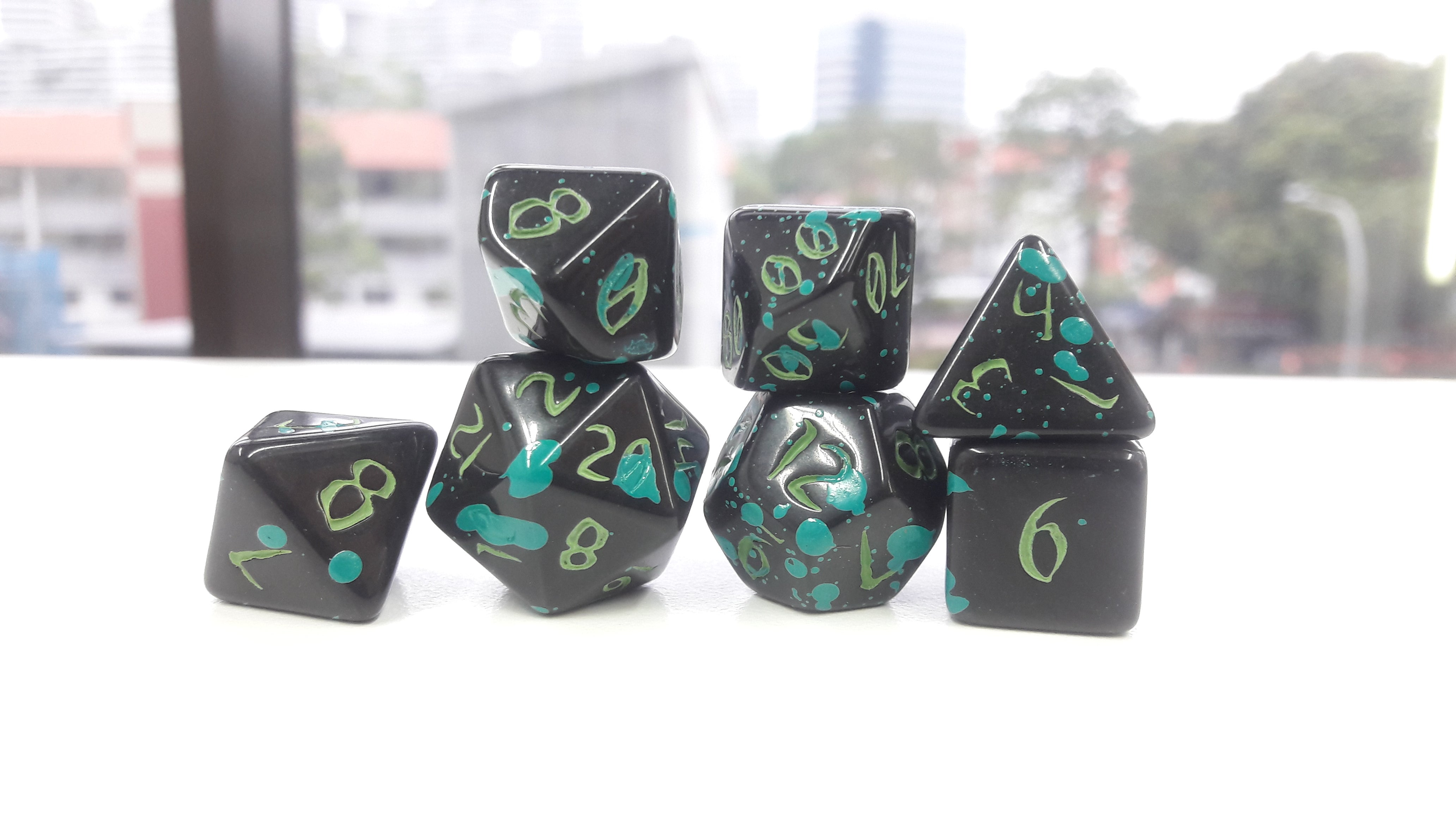 The Midnight Octopus - Primeval: Black and Teal with Green Ink 7pc Custom Font Polyhedral Dice Set - Kraken Dice | Sunny Pair'O'Dice