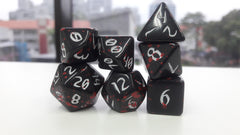 The Red Rain of Pain - Primeval: Black and Red with White Ink 7pc Custom Font Polyhedral Dice Set - Kraken Dice | Sunny Pair'O'Dice