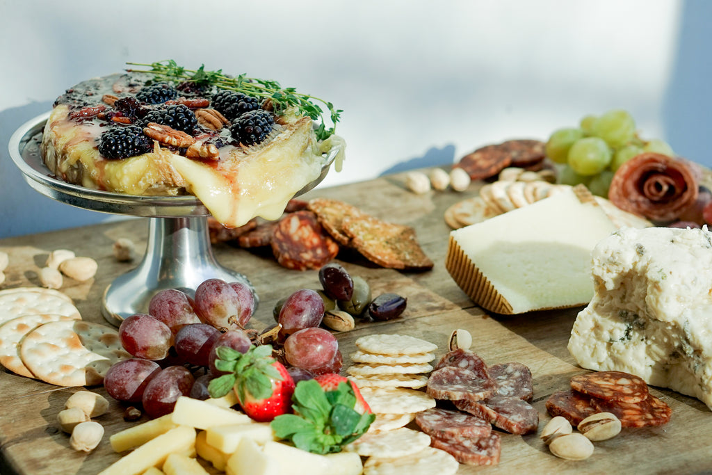 Blackberry and thyme baked brie with meat and cheese spread
