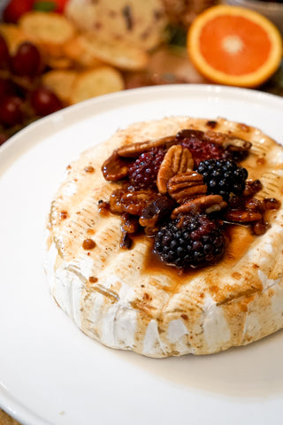Pecan and Raspberry Baked Brie Table and Thyme