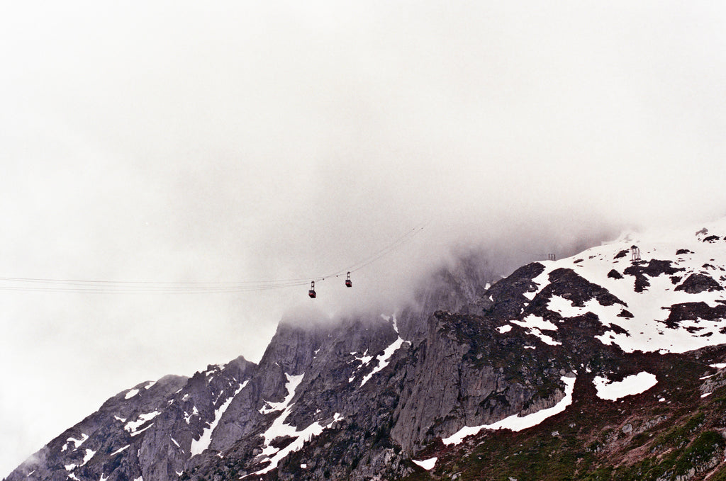 Cable cars near disappearing into cloud