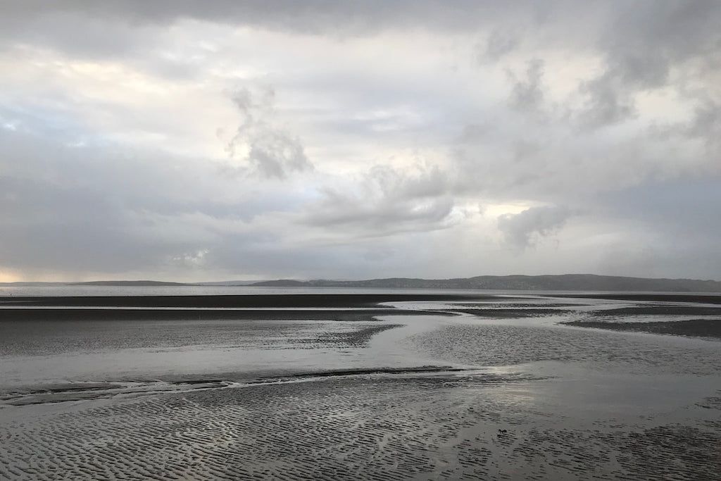 Silver grey mudflats and sky at dusk