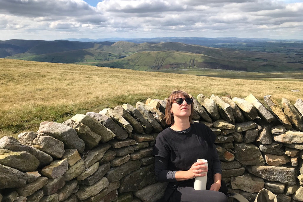 Woman hiker resting on top of Wild Boar Fell