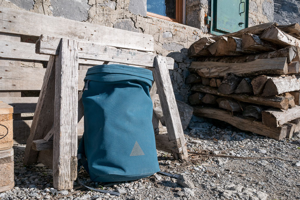 Blue backpack outside mountain hut